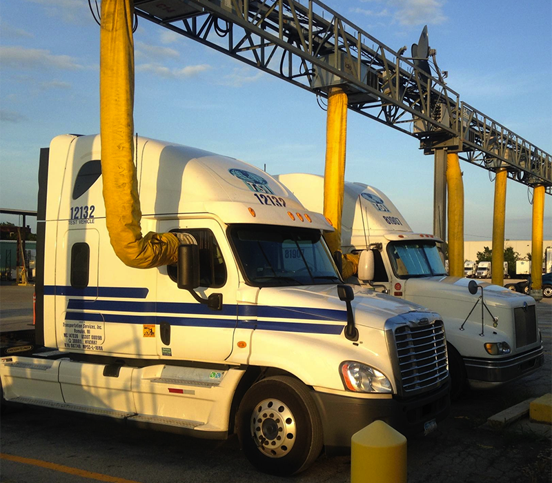 Photo of trucks parked at electrified parking spaces