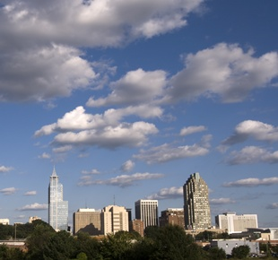 Photo of clouds over the city of Raleigh's sky scrapers.