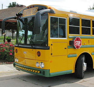 Photo of front end of yellow school bus.