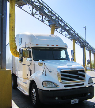 Photo of a tractor trailer hooked up to a truck stop electrification unit.