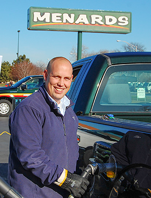 Menards store manager Kyle Krause fuels one of the company's new propane pickup trucks.