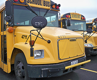 Photo of the Special School District of St. Louis county school bus fleet.