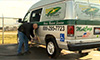 Photo of a man fueling a propane-powered medical transport vehicle