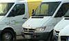 Photo of delivery trucks marked with the words