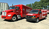 Photo of a Coca-Cola alternative-fuel truck and van.