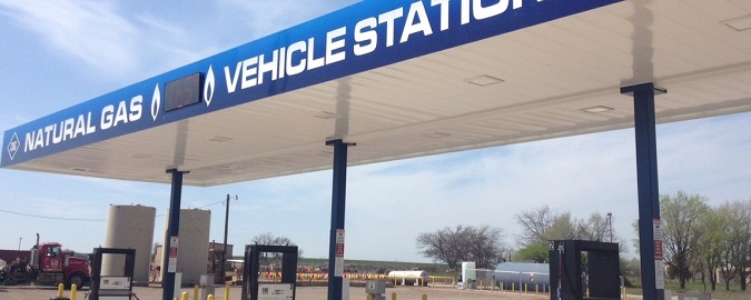 A photo of a fueling station with six pumps.