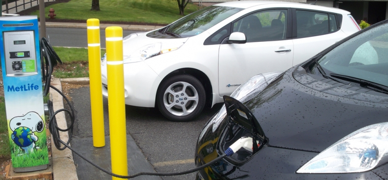 Photo of a plug-in electric vehicle connected to EVSE at a Met Life facility.
